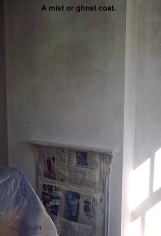 A ghost or mist coat applied to new plaster