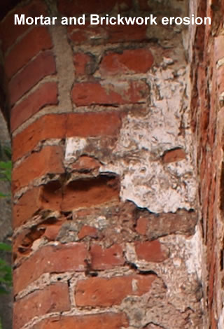 Mortar bed and brickwork erosion of a derelict building.   Illustrating an extreme case of. If left unnatended pointing   defects can cause damp in properties with a solid wall.