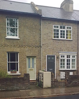 A typical Victorian terraced house in Twickenham   which does not have a physical damp course and may suffer from rising damp.
