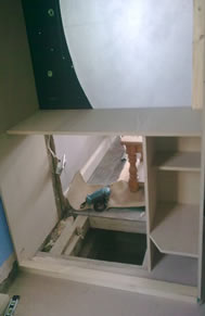 Carpentry skills required to build a framework  for a wardrobe leading to a cellar conversion.